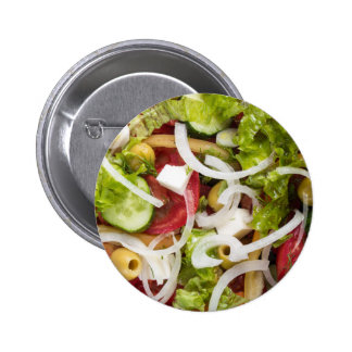 Top view of a salad made from natural vegetables 2 inch round button