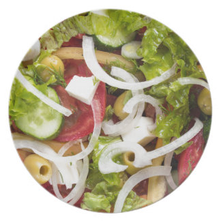 Top view of a salad made from natural vegetables plates