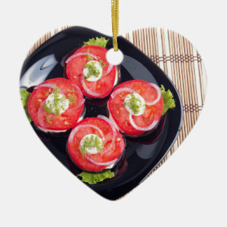 Top view of a sliced red tomatoes slices ceramic heart ornament