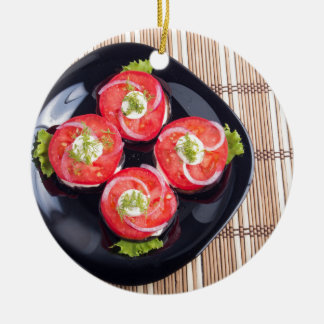 Top view of a sliced red tomatoes slices round ceramic ornament