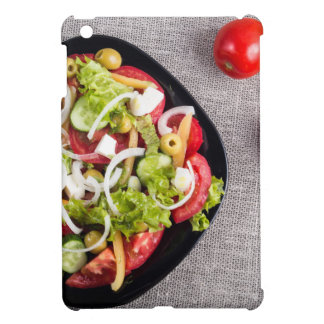 Top view of a small bowl of vegetables salad case for the iPad mini
