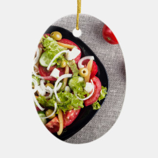 Top view of a small bowl of vegetables salad ceramic oval ornament