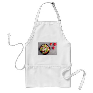Top view of a small bowl of vegetables salad standard apron