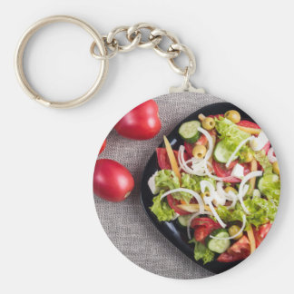 Top view of a small plate of raw salad basic round button keychain