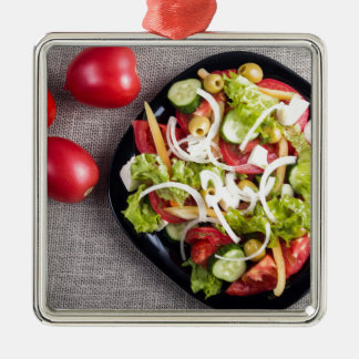 Top view of a small plate of raw salad Silver-Colored square ornament