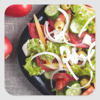 Top view of a small plate of raw salad square sticker
