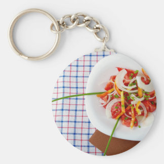Top view of a small portion of vegetarian salad basic round button keychain