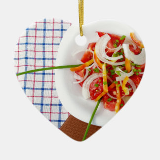 Top view of a small portion of vegetarian salad ceramic heart ornament