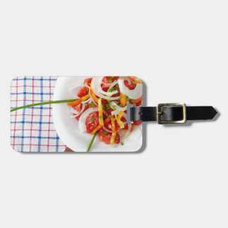 Top view of a small portion of vegetarian salad luggage tag