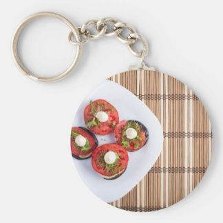 Top view of a vegetable dish of eggplant basic round button keychain
