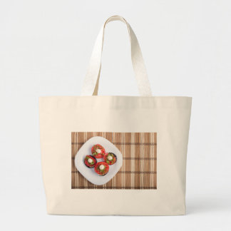 Top view of a vegetable dish of eggplant large tote bag