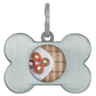 Top view of a vegetable dish of eggplant pet tags