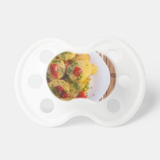 Top view of a vegetarian dish with organic vegetab pacifiers