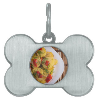 Top view of a vegetarian dish with organic vegetab pet ID tag