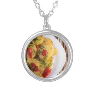 Top view of a vegetarian dish with organic vegetab silver plated necklace