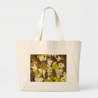 Top view of a wet autumn maple leaves large tote bag