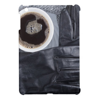 Top view of a white cup of coffee and black gloves iPad mini covers