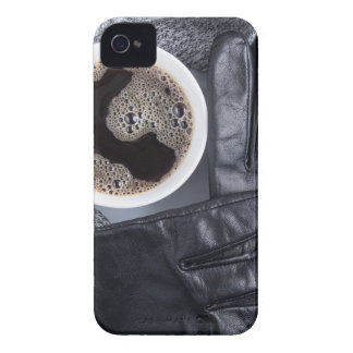 Top view of a white cup of coffee and gray woolen iPhone 4 cases