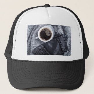 Top view of a white cup with coffee trucker hat