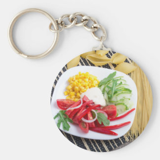 Top view of a white plate with salad keychain