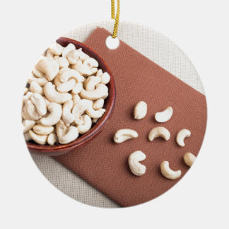Top view of breakfast for raw foodists round ceramic ornament