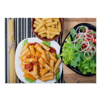Top view of cooked rigatoni pasta with vegetable poster