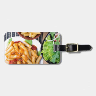 Top view of cooked rigatoni pasta with vegetables luggage tag