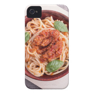 Top view of cooked spaghetti with tomato relish iPhone 4 covers