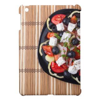 Top view of fresh vegetarian salad on a black iPad mini cases