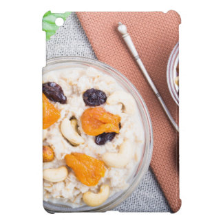 Top view of oatmeal porridge with raisins, cashews cover for the iPad mini