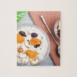 Top view of oatmeal porridge with raisins, cashews jigsaw puzzle