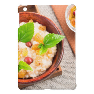 Top view of oatmeal with raisins, berries and herb iPad mini case