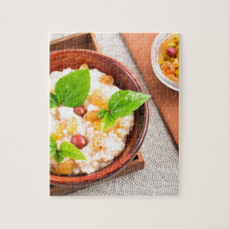 Top view of oatmeal with raisins, berries and herb jigsaw puzzle