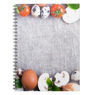 Top view of the food ingredients in the form notebook