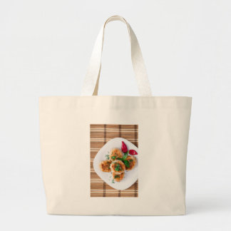 Top view of the fried meatballs with red pepper large tote bag