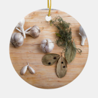 Top view of the garlic and dried spices round ceramic ornament