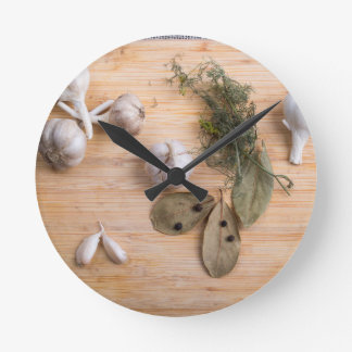 Top view of the garlic and dried spices round clock