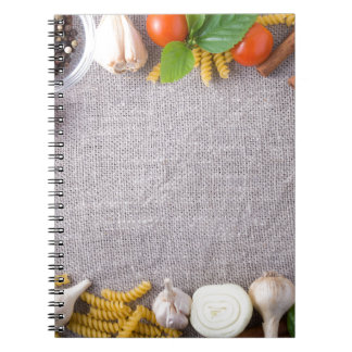 Top view of the ingredients for a meal notebooks