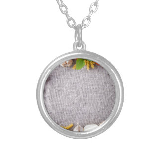 Top view of the ingredients for a meal silver plated necklace