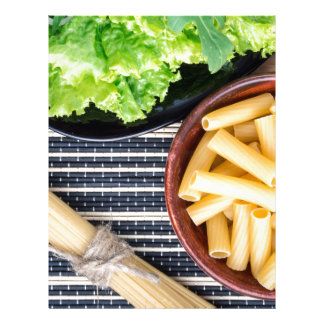 Top view of the ingredients for cooking food letterhead