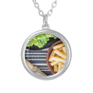 Top view of the ingredients for cooking food silver plated necklace