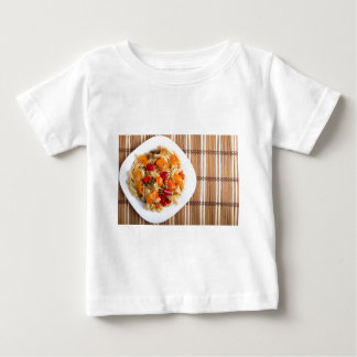 Top view of the Italian pasta on wooden background