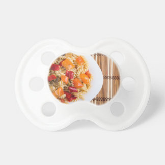 Top view of the Italian pasta on wooden background Pacifiers