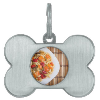 Top view of the Italian pasta on wooden background Pet Tag