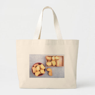 Top view of the pieces of dried bread large tote bag