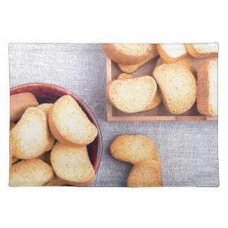 Top view of the pieces of dried bread placemat
