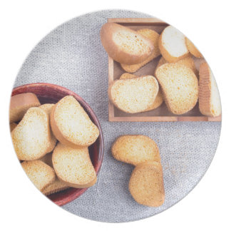 Top view of the pieces of dried bread plate