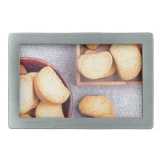 Top view of the pieces of dried bread rectangular belt buckles
