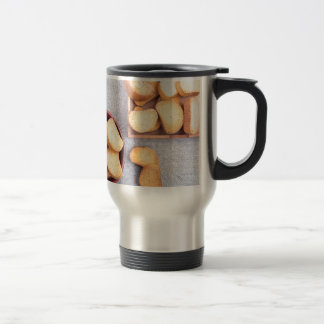 Top view of the pieces of dried bread travel mug