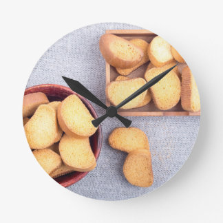 Top view of the pieces of dried bread wall clocks